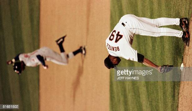 Baltimore Orioles relief pitcher Armando Benitez bends over after giving up the gamewinning home run in the 11th inning to Tony Fernandez 15 October...