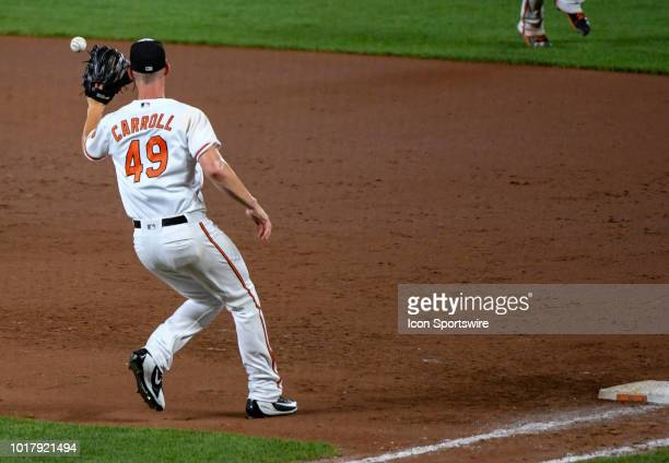 Baltimore Orioles relief pitcher Cody Carroll covers first base in the eighth inning during the game between the New York Mets and the Baltimore...