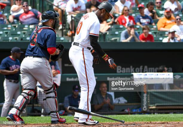 Baltimore Orioles right fielder Adam Jones drops his bat after striking out to end the first inning during the game between the Boston Red Sox and...