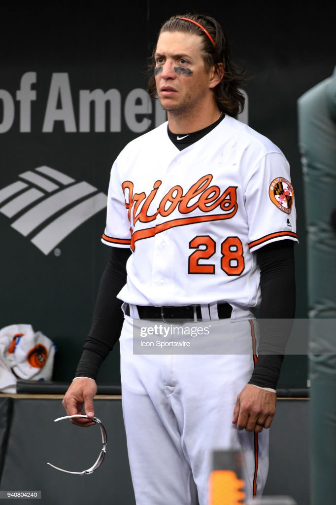Baltimore Orioles right fielder Colby Rasmus (28) stands in the dugout during game between the Minnesota Twins and the Baltimore Orioles on April 1, 2018, at Orioles Park at Camden Yards in Baltimore, MD.