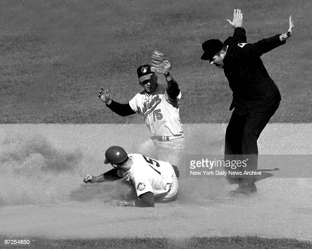 Baltimore Orioles second baseman Dave Johnson makes tag to late and N.Y. Mets Jerry Grote slides safely into second with a double in Game 4 of the...