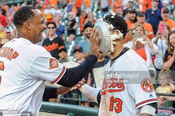 Baltimore Orioles second baseman Jonathan Schoop hits Baltimore Orioles third baseman Manny Machado with a pie after his walk off home run in the...