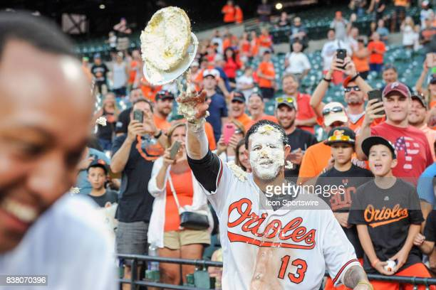 Baltimore Orioles second baseman Jonathan Schoop runs away after hitting third baseman Manny Machado with a pie after his walk off home run in the...