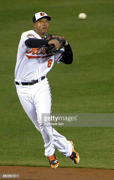 Baltimore Orioles second baseman Jonathan Schoop twists as he makes a rushed throw to first base on a grounder hit by Boston Red Sox batter Jackie...