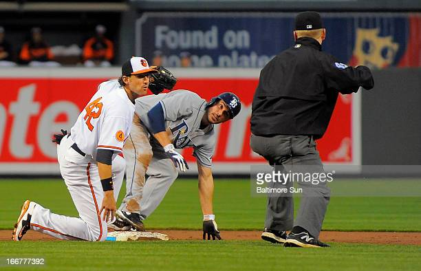 Baltimore Orioles second baseman Ryan Flaherty tags out Tampa Bay Rays base runner Matt Joyce at Oriole Park at Camden Yards in Baltimore Maryland...