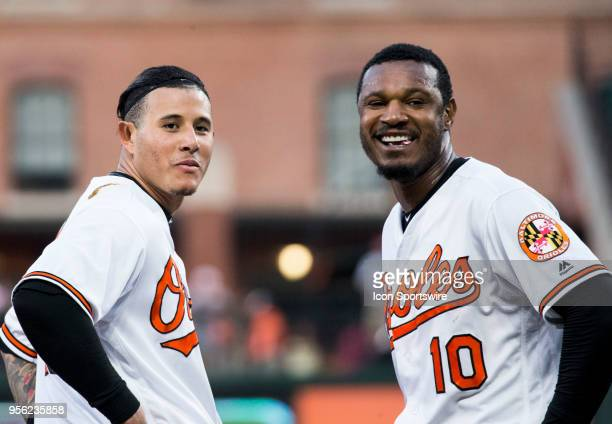 Baltimore Orioles shortstop Manny Machado and center fielder Adam Jones find something to smile about at the start of the second inning during an...