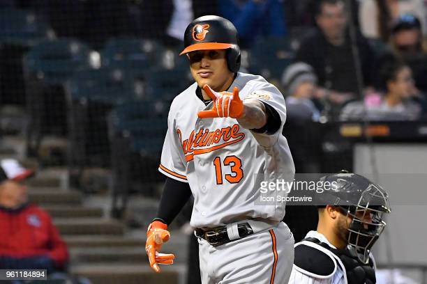 Baltimore Orioles shortstop Manny Machado makes a hand gesture at home plate after hitting a home run against the Chicago White Sox on May 21 2018 at...