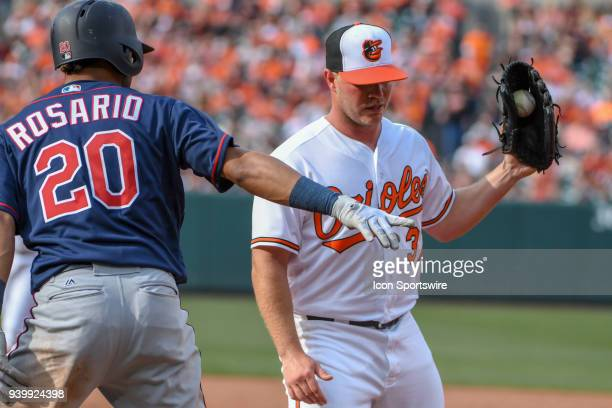 Baltimore Orioles starting pitcher Dylan Bundy covers first base to retire Minnesota Twins left fielder Eddie Rosario during the Opening Day game...