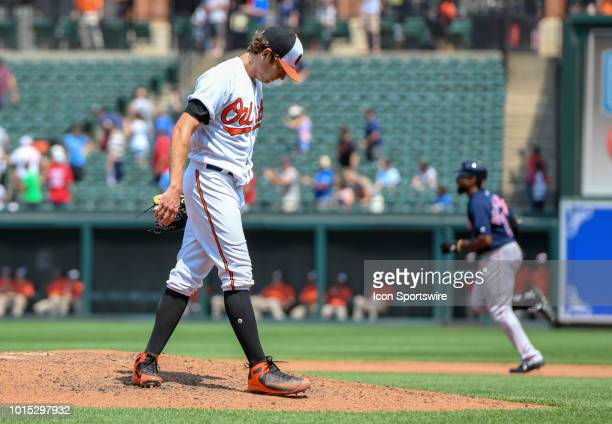 Baltimore Orioles starting pitcher Jimmy Yacabonis stands on the mound after giving up a fifth inning solo home run to Boston Red Sox center fielder...
