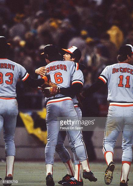 Baltimore Orioles' teammates Doug DeCinces and Eddie Murray rush to congratulate pitcher Scott McGregor after his complete game win in game 3 against...