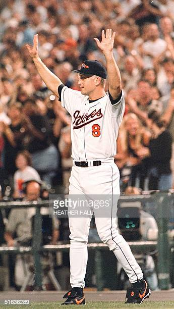 Baltimore Orioles third baseman, Cal Ripken Jr., acknowledges the applause of the crowd, 20 September at Camden Yards in Baltimore, MD. Ripken said...