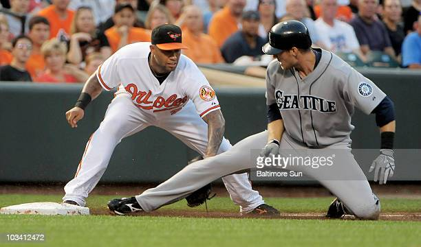 Baltimore Orioles third baseman Josh Bell tags out Seattle Mariners' Michael Saunders in the second inning at Oriole Park at Camden Yards in...