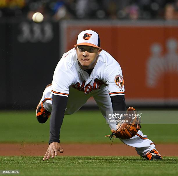 Baltimore Orioles third baseman Manny Machado makes a diving catch on an infield looper hit by Toronto Blue Jays' Ryan Goins during the fifth inning...