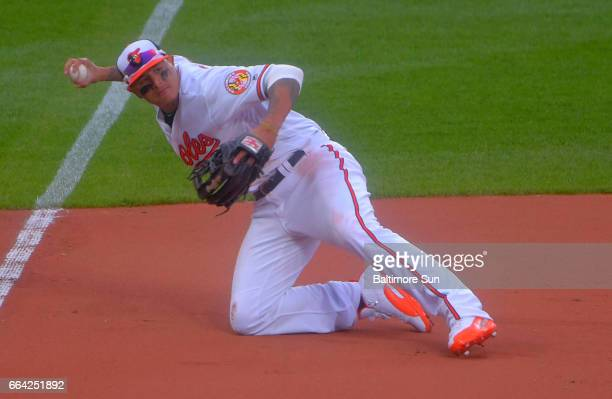 Baltimore Orioles third baseman Manny Machado spears a hard hit by Toronto Blue Jays second baseman Devon Travis recovering in time to throw on one...