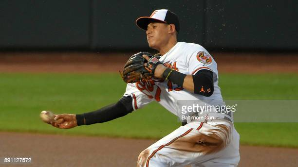 Baltimore Orioles third baseman Manny Machado throws from behind second base after snaring a grounder hit by the Texas Rangers' ShinSoo Choo during...