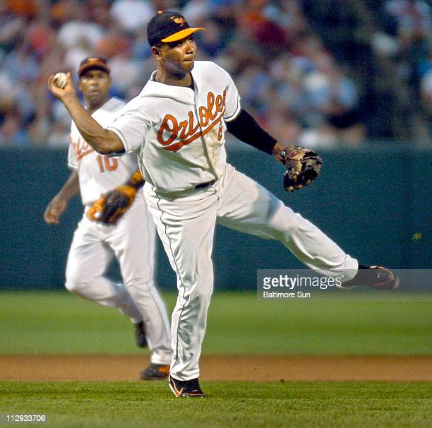 Baltimore Orioles' third baseman Melvin Mora fires a throw across to first base to nail Philadelphia Phillies' Abraham Nunez for an RBI groundout in...