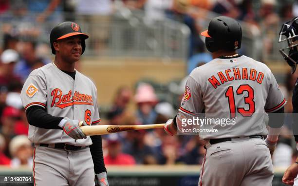 Baltimore Orioles's Jonathan Schoop right hands Manny Machado his bat after Machado hit a foul ball in the third inning of their Major League...