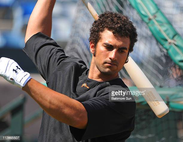 Baltimore outfielder Nick Markakis loosens up while waiting for his turn in the batting cage during spring training in Fort Lauderdale Florida...