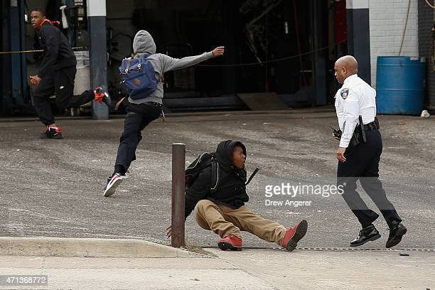 Baltimore Police Commissioner Anthony Batts chases away protestors in a parking lot on Reisterstown Road near Mowdamin Mall April 27 2015 in...