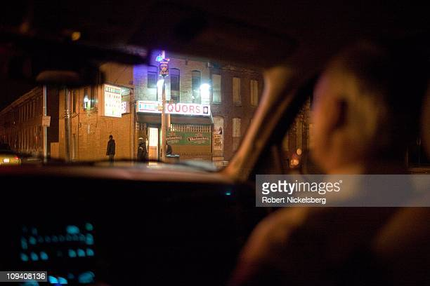 Baltimore Police Commissioner Fred Bealefeld lll, right, watches a corner liquor shop October 19, 2010 in Baltimore, Maryland. Commissioner Bealefeld...