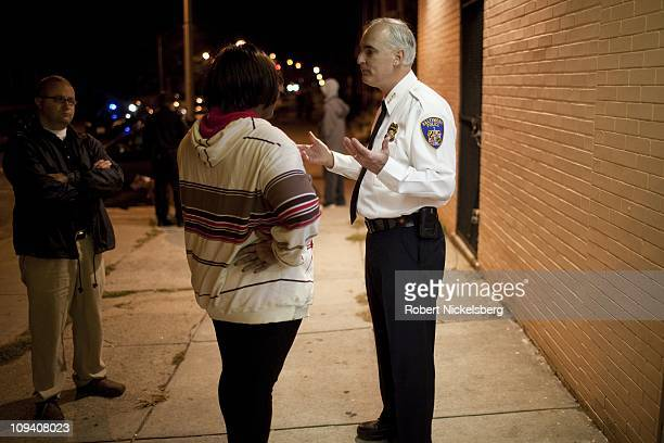 Baltimore Police Commissioner Fred Bealefeld lll, speaks with the mother of a juvenile who became belligerent with police in a variety store October...