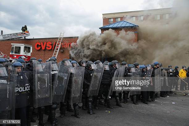 Baltimore Police form a parimeter around a CVS pharmacy that was looted and burned near the corner of Pennsylvania and North avenues during violent...