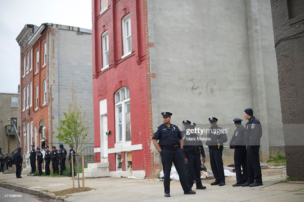 Baltimore Police officers gather near the Western District Police Station in anticipation of a protest in honor of Freddie Gray April 25, 2015 in Baltimore, Maryland. Gray, 25, was arrested for possessing a switch blade knife April 12 outside the Gilmor Homes housing project on Baltimore's west side. According to his attorney, Gray died a week later in the hospital from a severe spinal cord injury he received while in police custody.