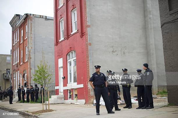 Baltimore Police officers gather near the Western District Police Station in anticipation of a protest in honor of Freddie Gray April 25 2015 in...