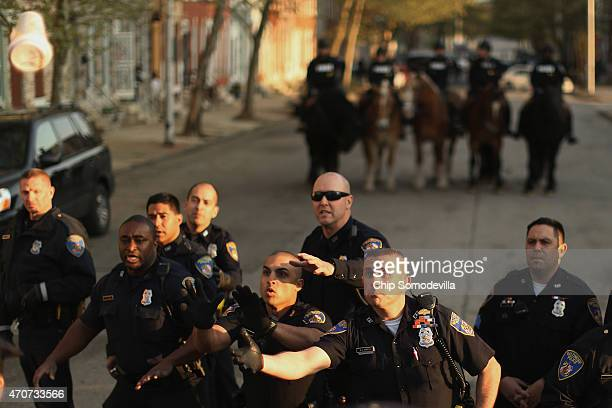 Baltimore Police react to objects thrown by demonstrators during a protest against police brutality and the death of Freddie Gray outside the...