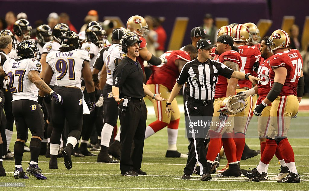 Baltimore Raven head coach John Harbaugh tries to separate the teams during second-quarter action in Super Bowl XLVII at the Mercedes-Benz Superdome in New Orleans, Louisiana, Sunday, February 3, 2013.