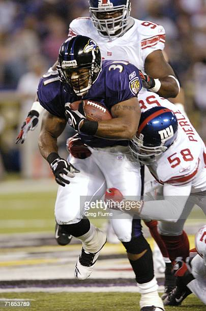 Baltimore Raven Jamal Lewis rushes against the New York Giants August 11 2006 at MT Bank Stadium in Baltimore Maryland