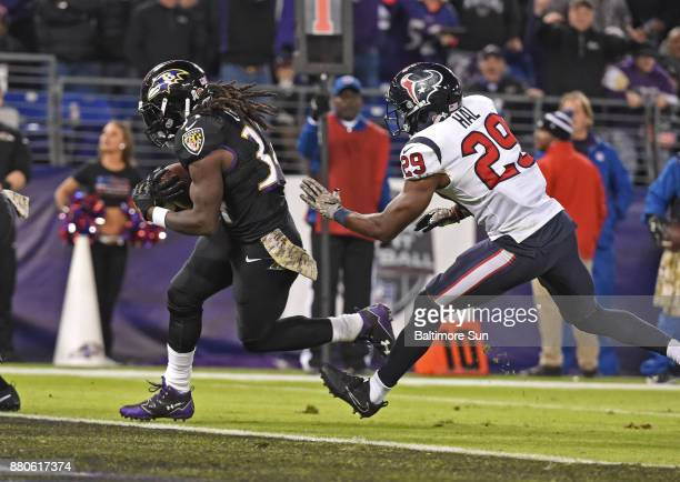 Baltimore Ravens' Alex Collins runs for a second quarter touchdown against the Houston Texans on Monday Nov 27 2017 at MT Bank Stadium in Baltimore Md