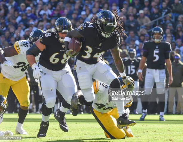 Baltimore Ravens' Alex Collins rushes for a gain in the first quarter against the Pittsburgh Steelers on Sunday Nov 4 2018 at MT Bank Stadium in...