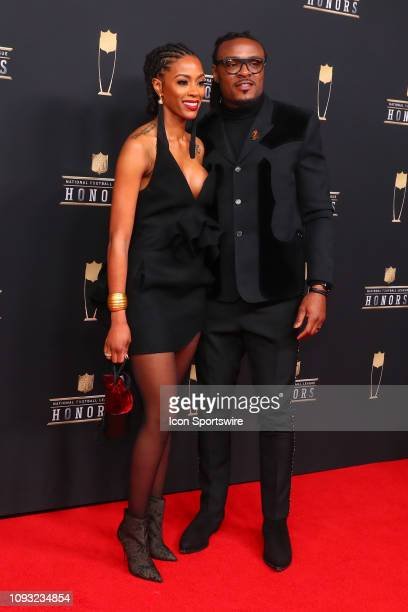 Baltimore Ravens Brandon Carr and his wife Shatory Campbell pose for photos on the red carpet at the NFL Honors on February 2 2019 at the Fox Theatre...