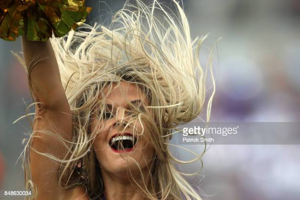 Baltimore Ravens cheerleader performs as the Baltimore Ravens play the Cleveland Browns at MT Bank Stadium on September 17 2017 in Baltimore Maryland
