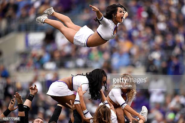 Baltimore Ravens cheerleaders perform during an NFL game between the San Diego Chargers and the Baltimore Ravens at MT Bank Stadium on November 30...