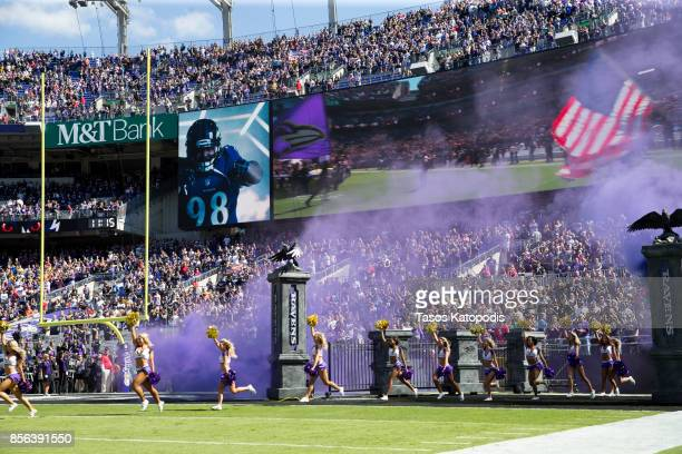 Baltimore Ravens cheerleaders take the field before the Ravens take on the Pittsburgh Steelers at MT Bank Stadium on October 1 2017 in Baltimore...