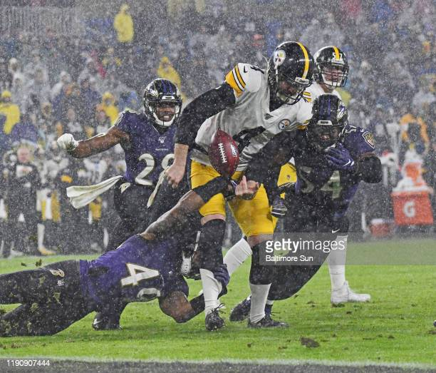 Baltimore Ravens' Chris Board left knocks the ball loose from Pittsburgh Steelers punter Jordan Berry center in the fourth quarter on Sunday Dec 29...