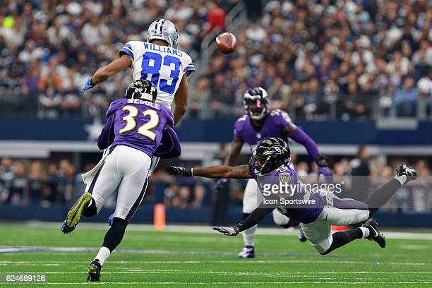 Baltimore Ravens Cornerback Jerraud Powers and Safety Eric Weddle break up a pass intended for Dallas Cowboys Wide Receiver Terrance Williams during...