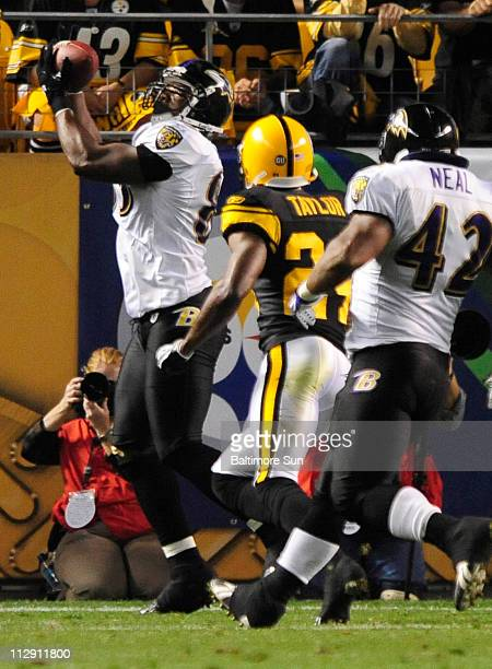 Baltimore Ravens' Daniel Wilcox catches a pass for a touchdown in the first half against Pittsburgh Steelers' Ike Taylor in Pittsburgh Pennsylvania...
