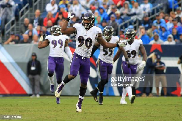 Baltimore Ravens defender Za'Darius Smith and teammates dance in unison to celebrate a forced fumble during the Tennessee Titans game against the...
