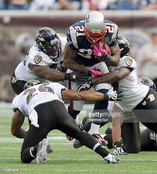 Baltimore Ravens' defenders including Dawan Landry and Terrell Suggs stop New England Patriots Fred Taylor after a gain of 13 yards during...