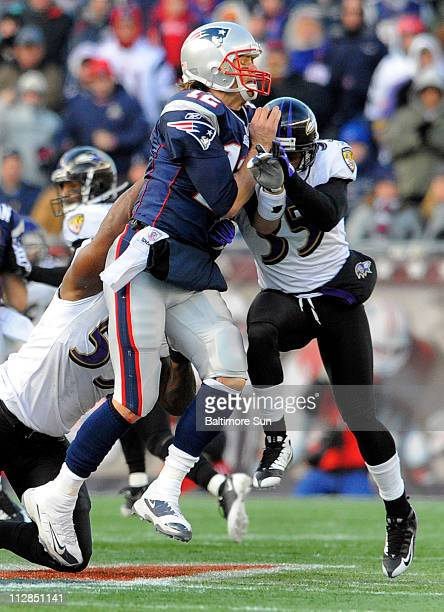 Baltimore Ravens defenders Terrell Suggs and Corey Ivy put pressure on New England Patriots quarterback Tom Brady during the second quarter of an AFC...