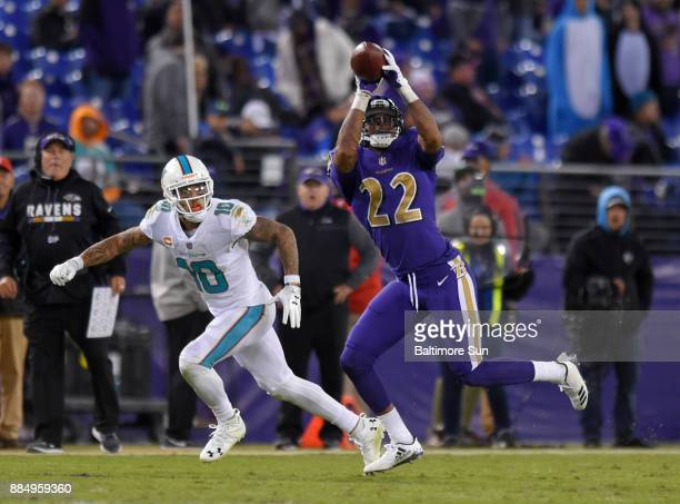Baltimore Ravens defensive back Jimmy Smith intercepts a fourth quarter pass and retuns it 50 yards for a touchdown on a pass intended for the Miami...