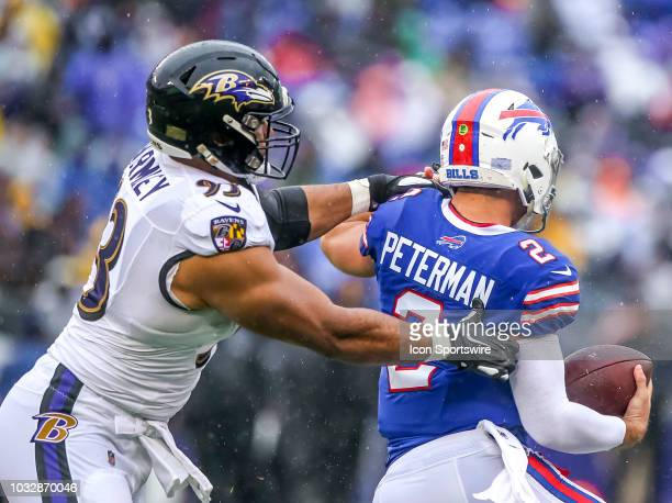 Baltimore Ravens defensive end Chris Wormley brings down Buffalo Bills quarterback Nathan Peterman for a sac during a game between the Buffalo Bills...
