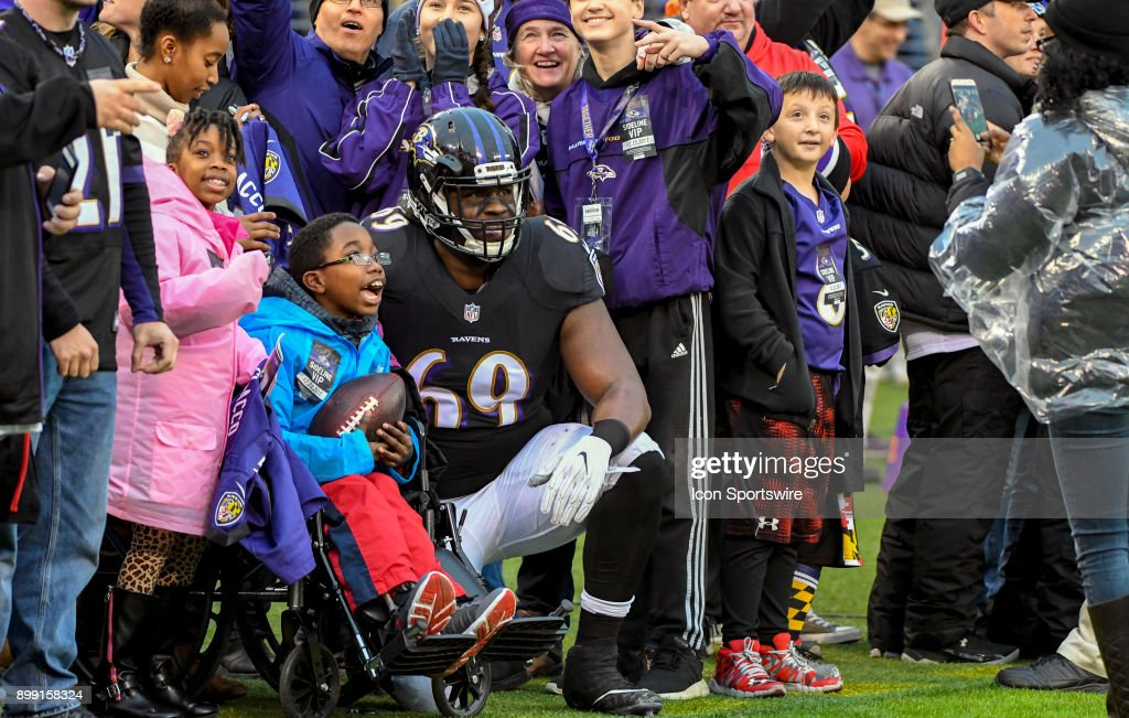 Baltimore Ravens Defensive Tackle Willie Henry (69) Visits With A Young  Wheel Chair Bound