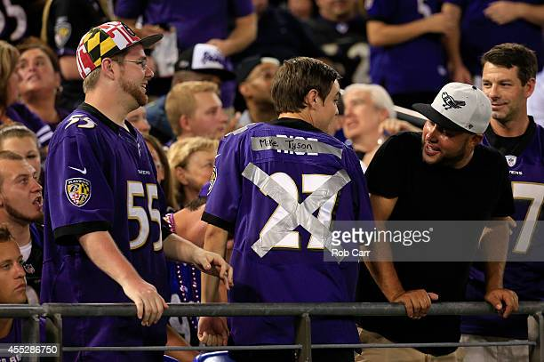 Baltimore Ravens fan tapes over his Ray Rice jersey with the words Mike Tyson during the game against the Pittsburgh Steelers at MT Bank Stadium on...