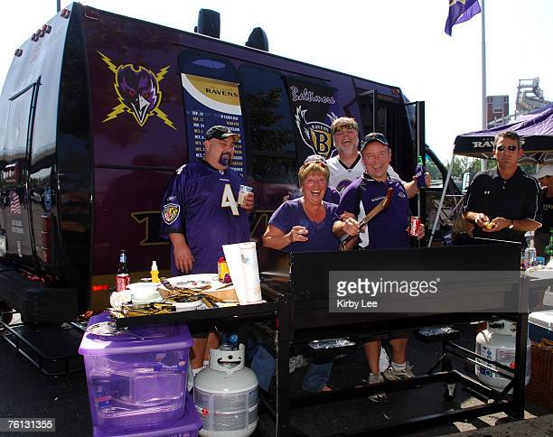 Baltimore Ravens fans barbecue in the parking lot of MT Bank Stadium during tailgate festivities before game against the Oakland Raiders in Baltimore...
