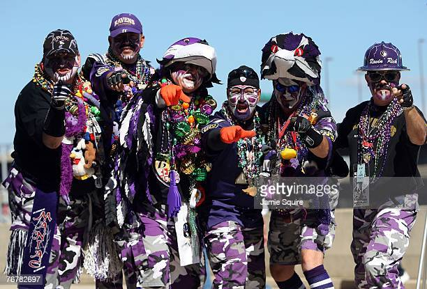 Baltimore Ravens fans pose at a tailgate party prior to the game against the New York Jets on September 16 2007 at MT Bank Stadium in Baltimore...