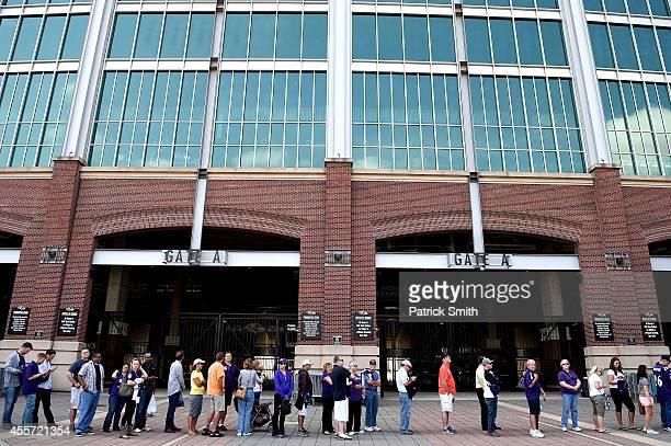 Baltimore Ravens fans stand in line to exchange the jersey of former running back Ray Rice of the Baltimore Ravens at MT Bank Stadium on September 19...